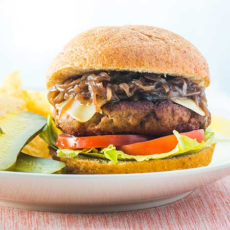 Backyard Burgers with Grape Jelly Caramelized Onions