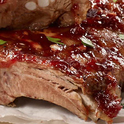 Juicy, tender and hot slow cooked cranberry barbecue pork ribs.
